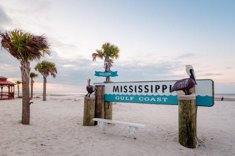 A beachfront sign welcoming visitors to Mississippi's Gulf Coast
