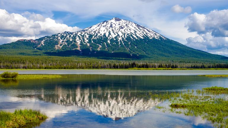 A view of Mount Bachelor with its reflection in a lake