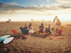 Bonfire on the beach at sunset in Huntington Beach, California