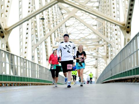 A happy runner coasts through the Sault International Festival of Races