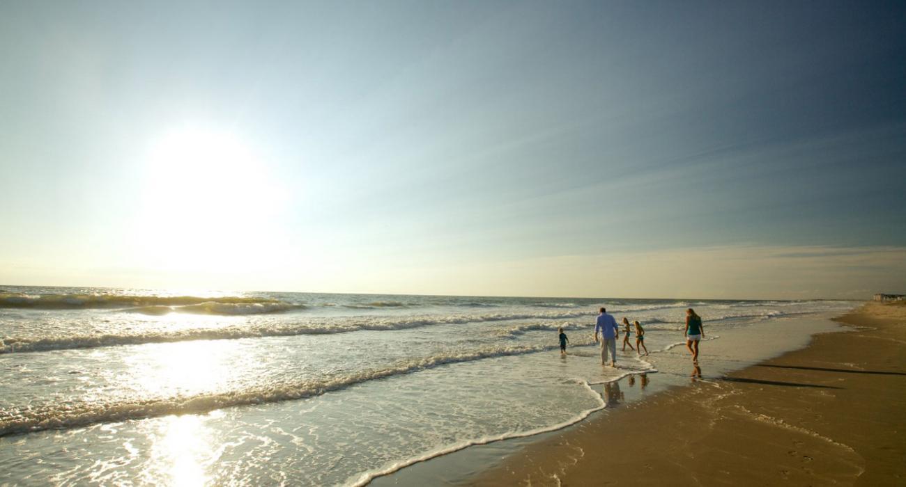 Family Enjoying The Beach At Sandbridge In Virginia