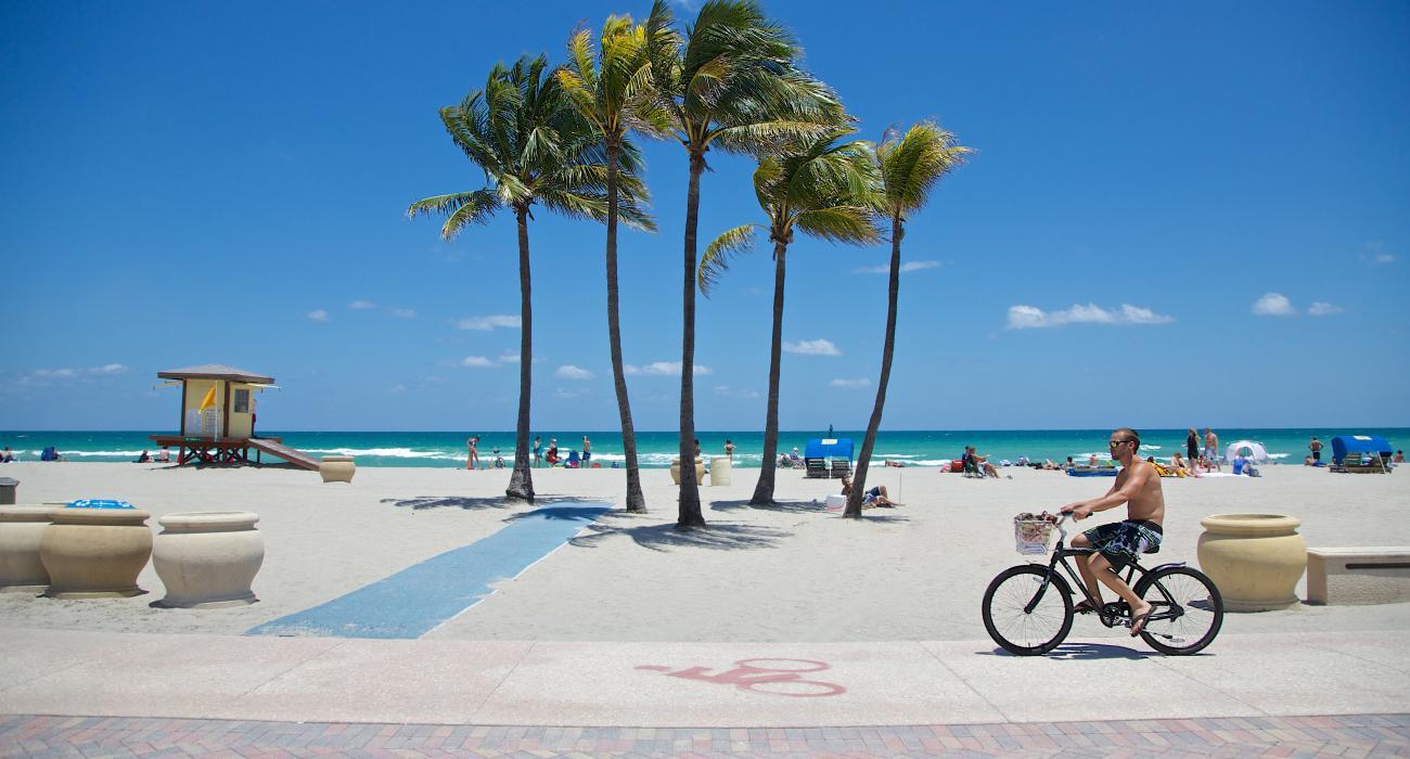 Biking Along The Beach Boardwalk In Fort Lauderdale