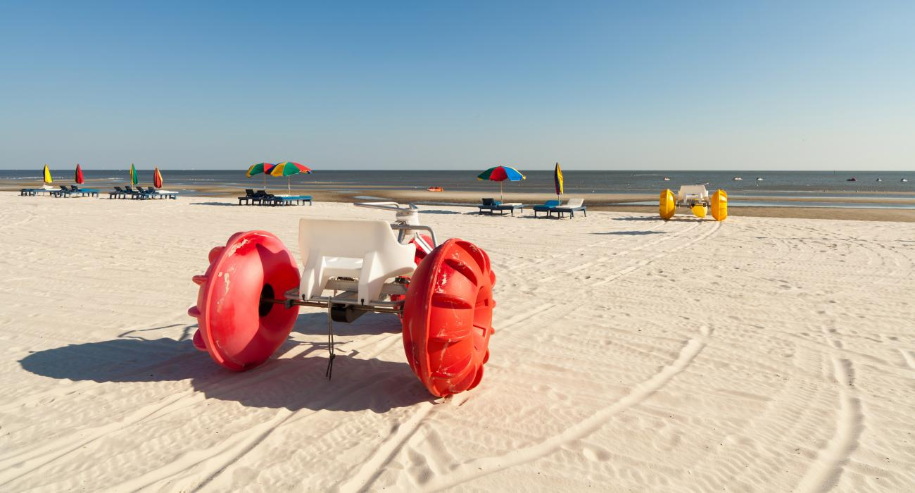 Colorful Beach Tricycles Along The Sline Of Biloxi