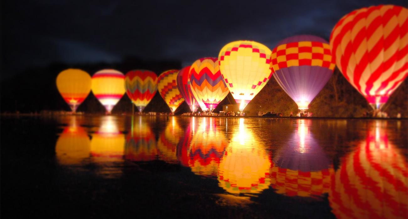 Soft glow of hot-air balloons lighting up the riverfront & Cincinnati Ohio: Museums Festivals and Riverfront Attractions
