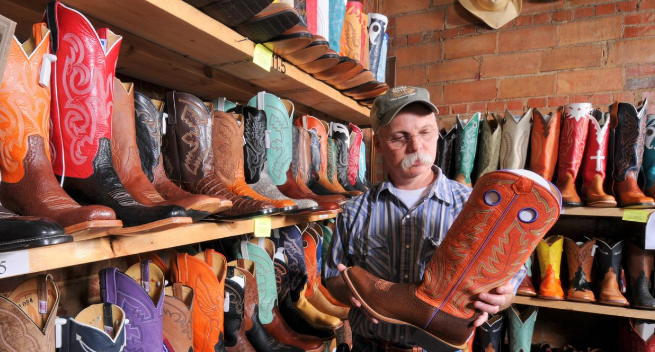Admiring Cowboy Boots At The Stockyard City Boot Merchant