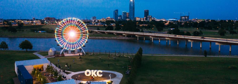 Lights of the Wheeler Ferris Wheel overlooking the Oklahoma River and downtown Oklahoma City