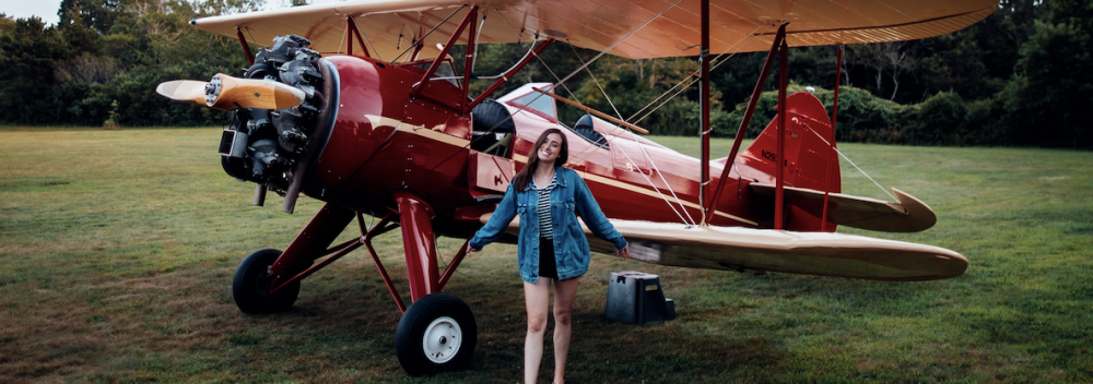 Posing with a biplane at Cape Cod Airfield in Massachusetts